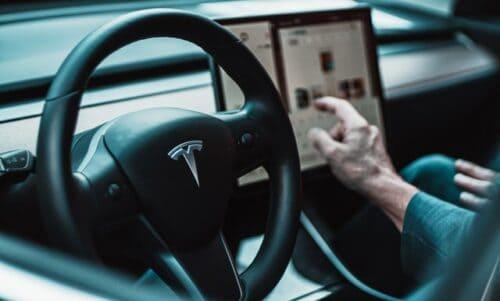 behind the wheel of a Tesla