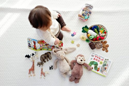 young child playing with toys