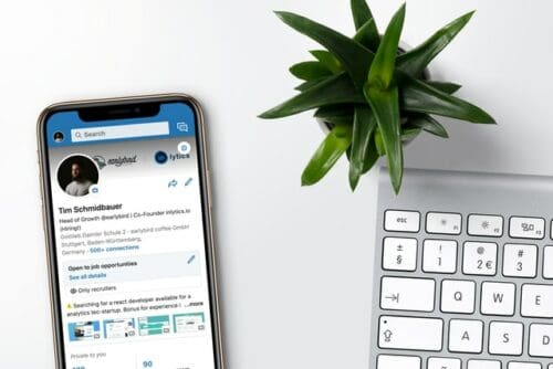 LinkedIn app with keyboard and plant