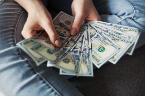 hands fanning money