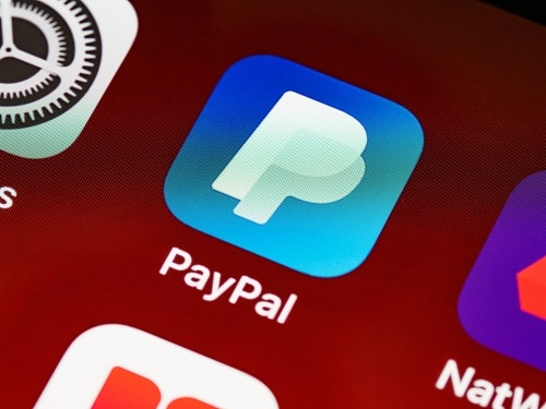 how does paypal make money